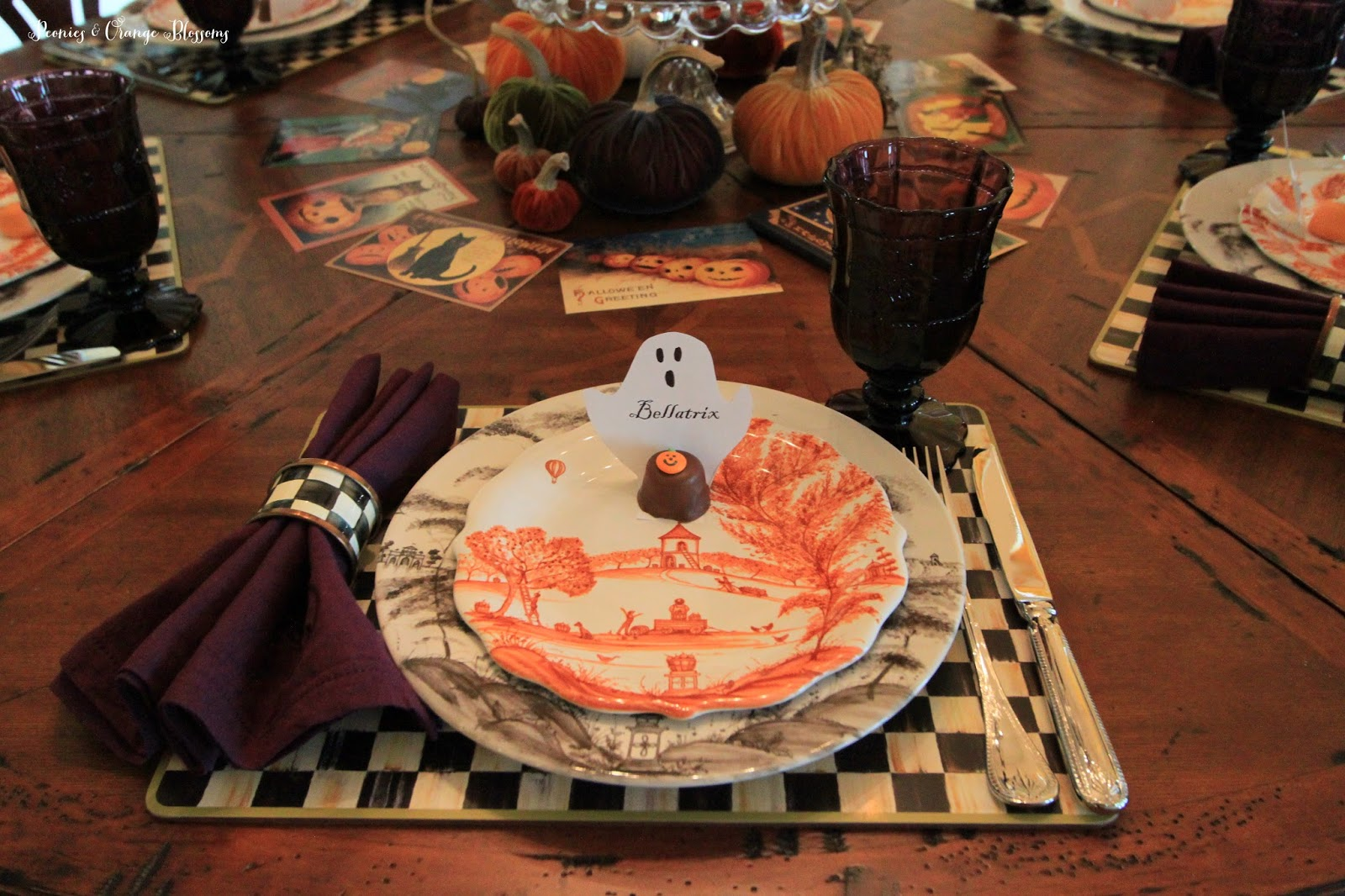 each place setting is completed with a ghastly ghost name card holder these took me just a few minutes to make simply print off your guests name in a - Halloween Place Settings