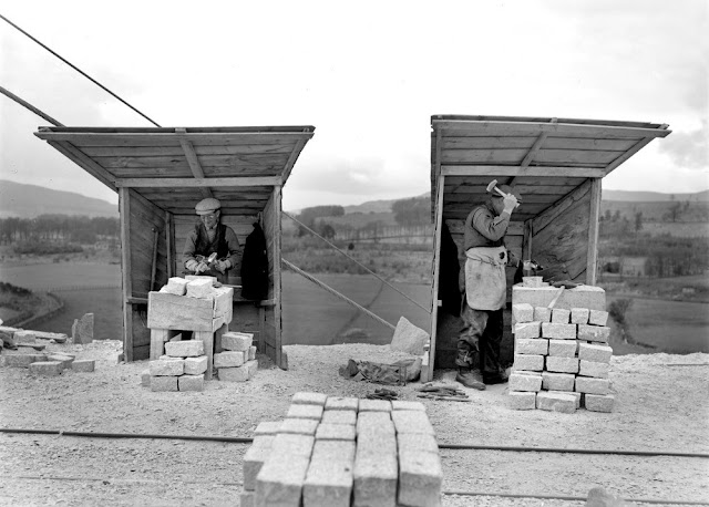 Kemnay Quarries. Aberdeenshire. Sett-makers working in their individual huts, locally called scathies.