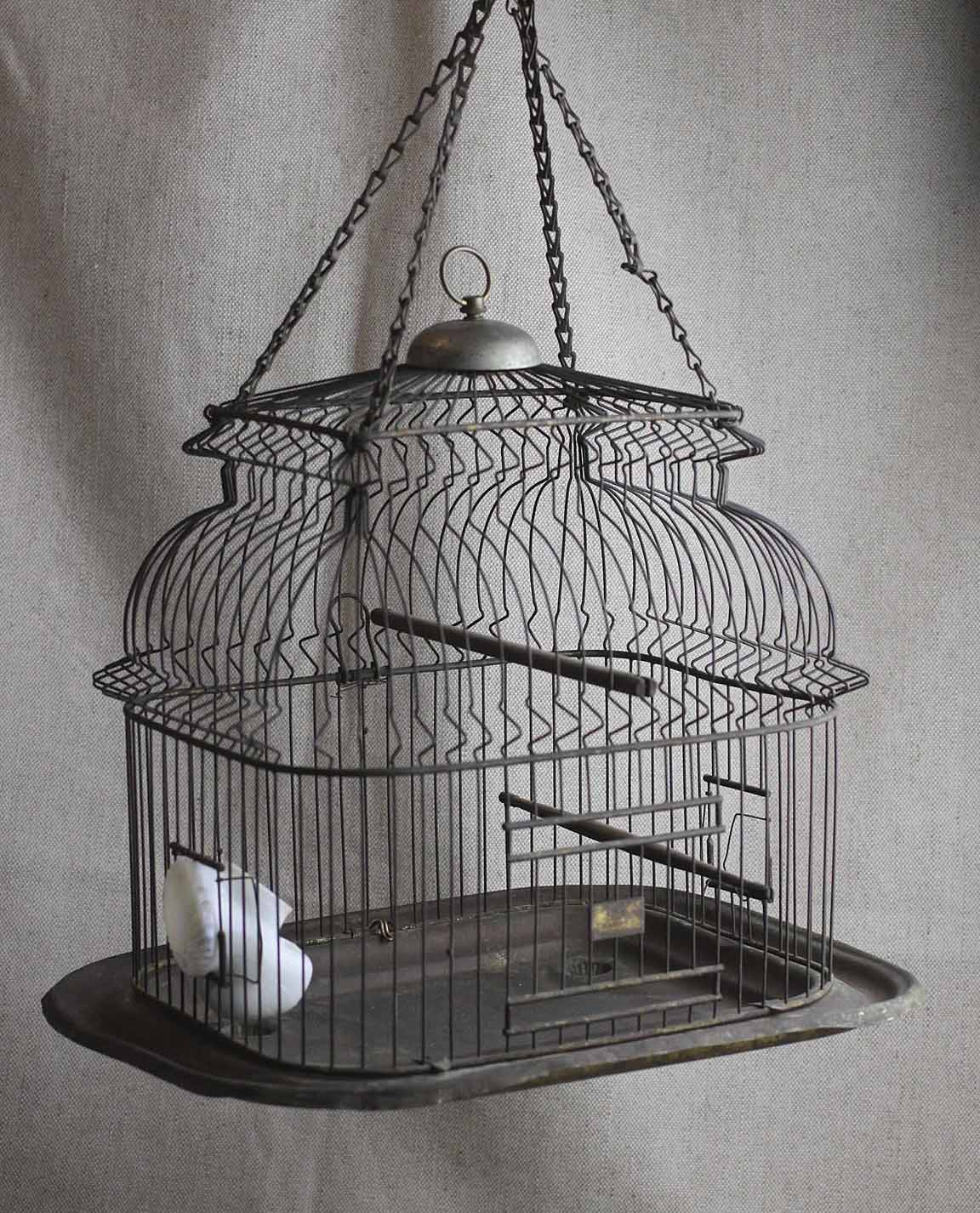Bliss Farm Antiques Antique Bird Cage. Rustic Wine Racks. Modern Alarm Clock. Exterior Barn Doors. 3 Way Mirror. Brown Kitchen Backsplash. Limestone Countertops. Screened Porch. Industrial Dining Table