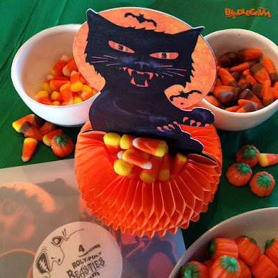 This black cat candy-basket is surrounded by sugar candycorns and pumpkins next to a package of Bindlegrim's Halloween Beasties.