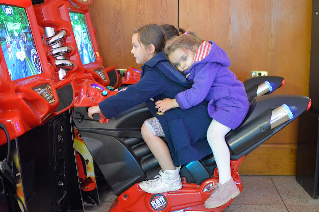 Girls on motorbike arcade