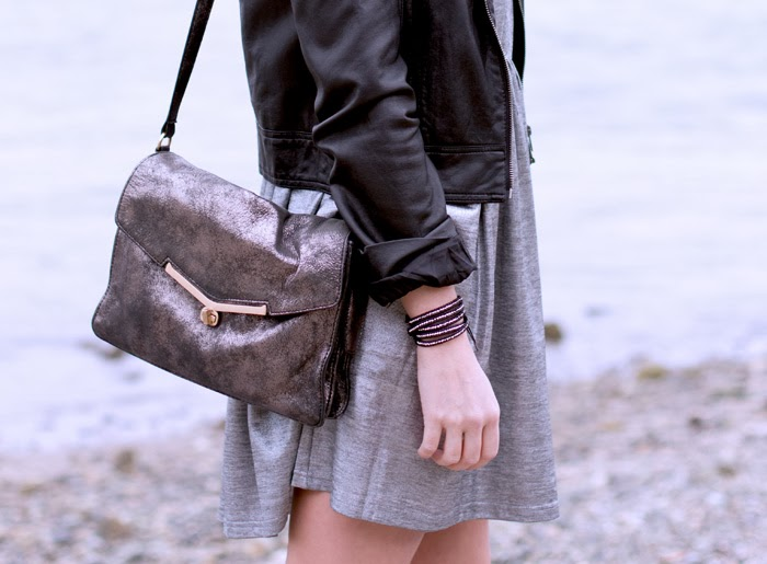 Vancouver Fashion Blogger, Alison Hutchinson, is wearing a MinkPink silver dress, Forever 21 leather jacket, Topshop western boots, botkier valentina bag, and a privilege clothing bracelet