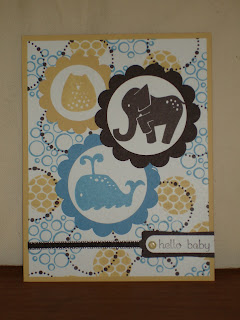 Baby card with stamped circle background and elephant, owl and whale images.