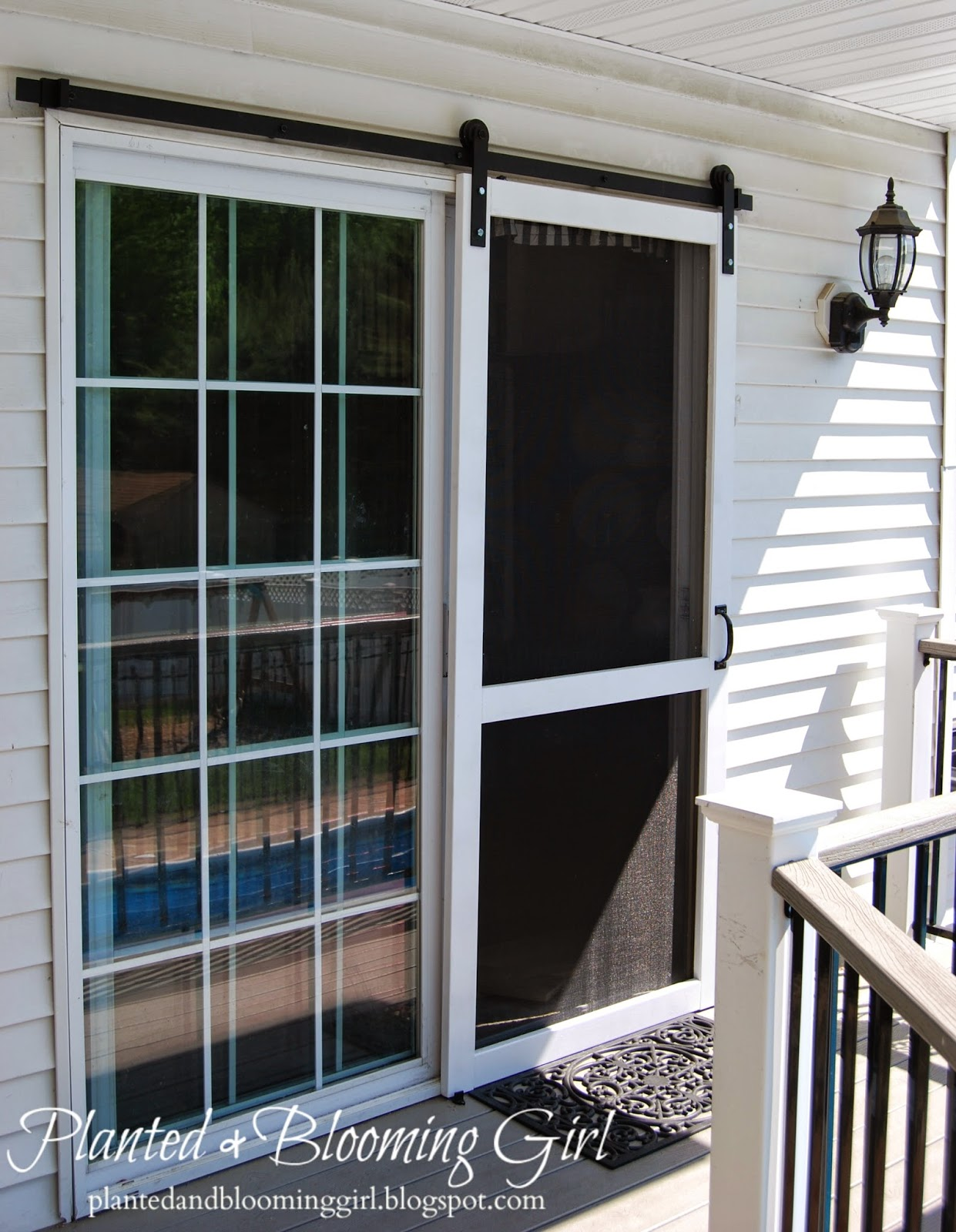 Cure 4 decor how to add a barn track sliding screen door for Screen door for sliding glass door