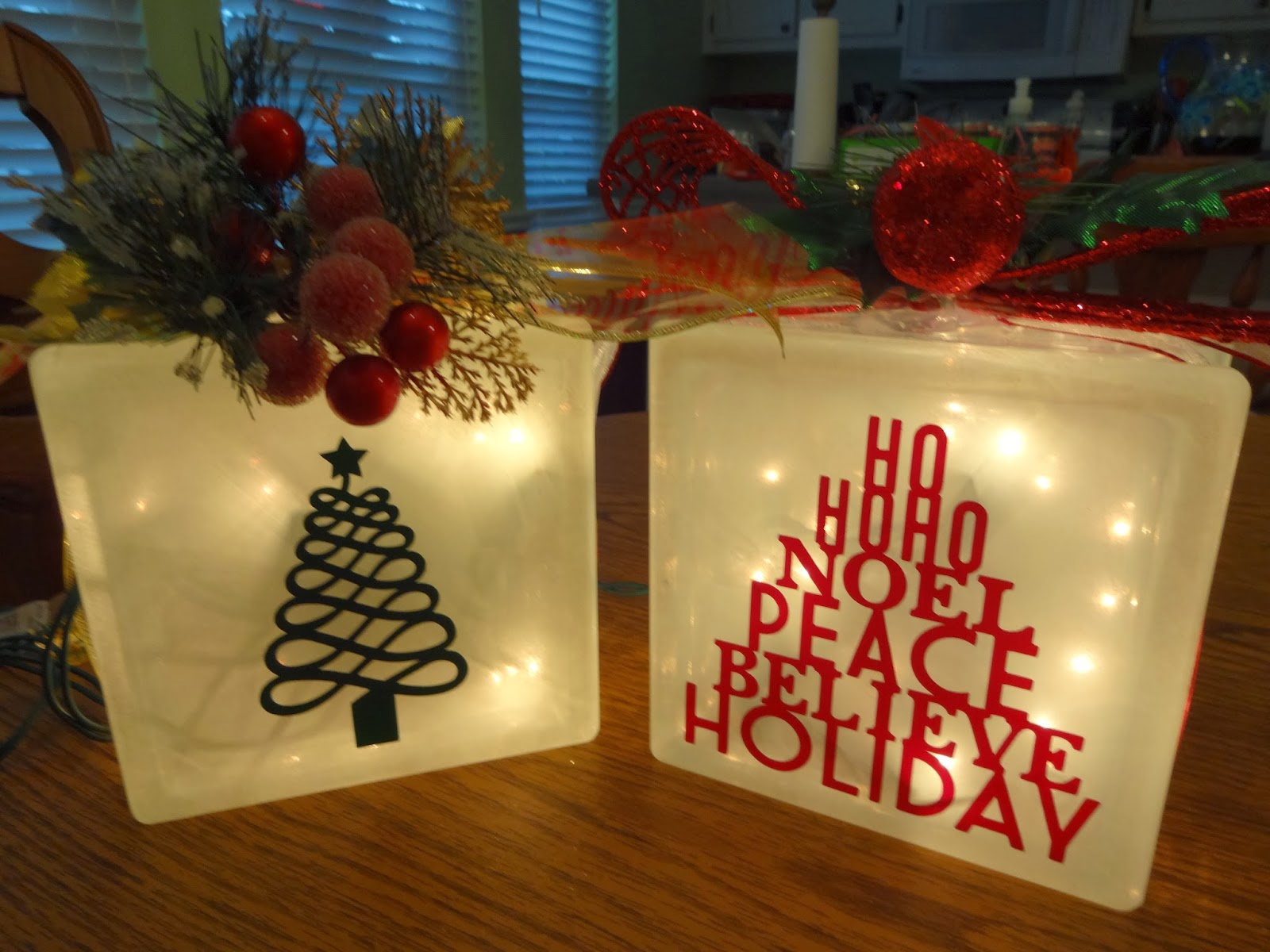 this year i decided to make decorated glass blocks with vinyl and the teresa collins december 25th cricut cartridge this is what they look like front and - Christmas Glass Blocks