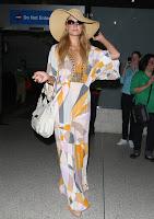 Paris Hilton strikes a pose in a retro dress at LAX airport