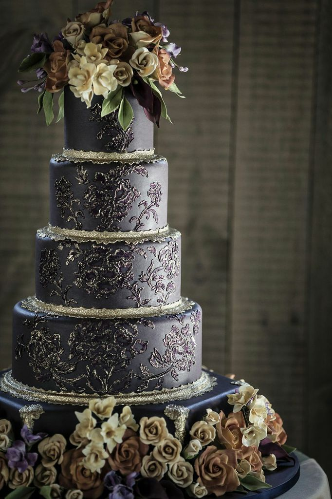 Handcrafted Sugar Flowers Adorn The Base Of Custom Wedding Cake