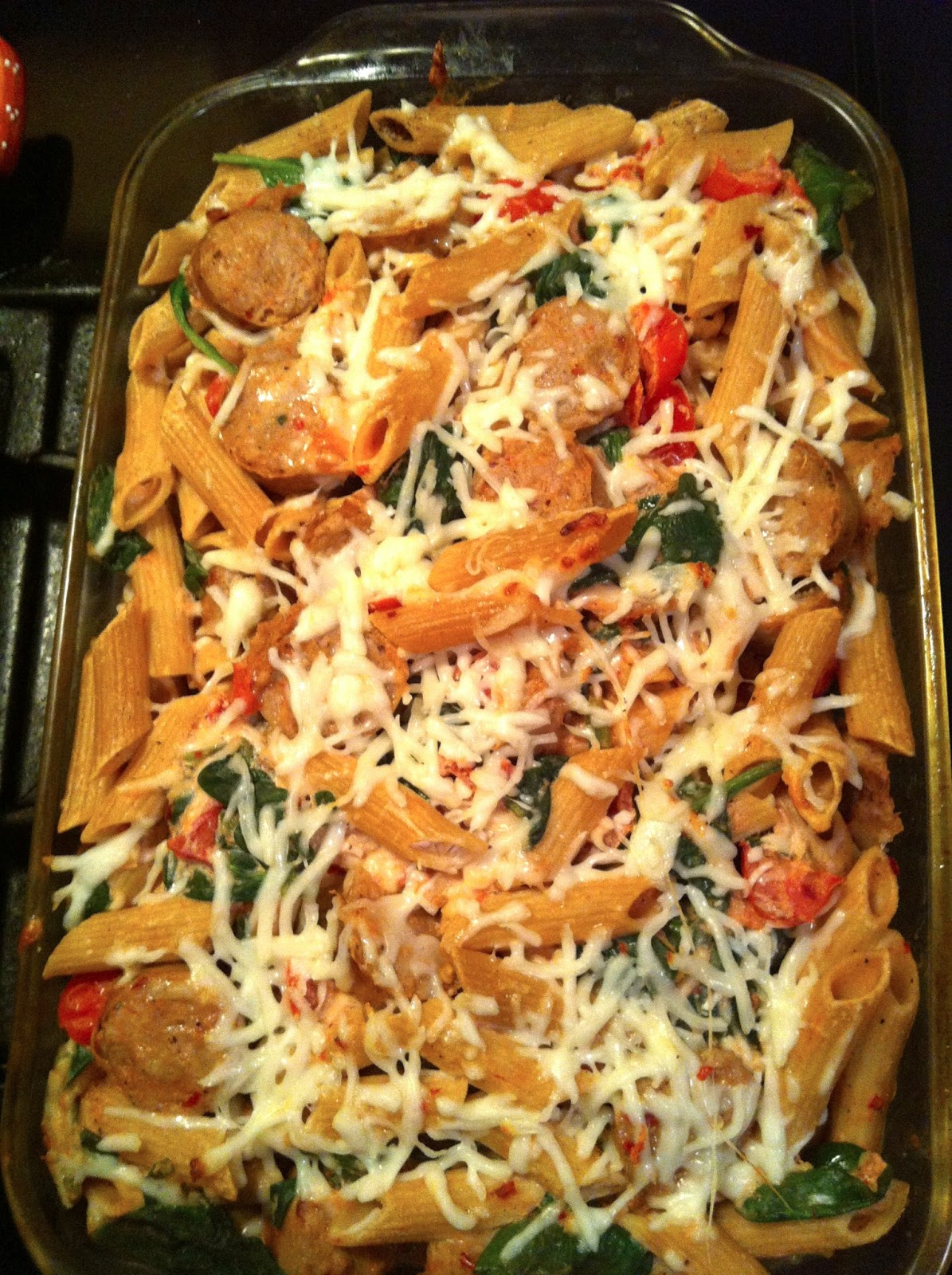 light pasta bake with chicken sausage, mozzarella, spinach & tomatoes