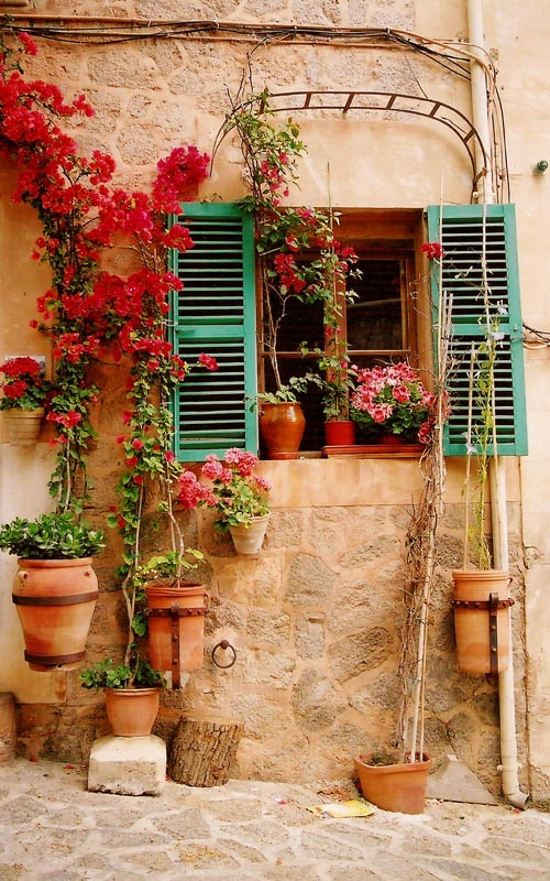 Shutters balconies and spanish on pinterest for Spanish style window shutters