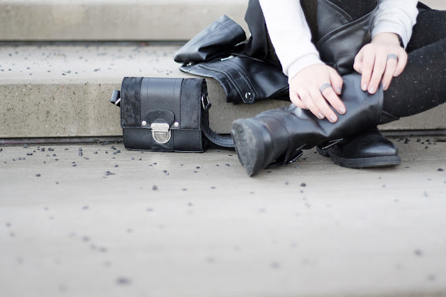 black mini bag and biker boots