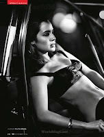 Berenice Marlohe putting on some clothes in the car