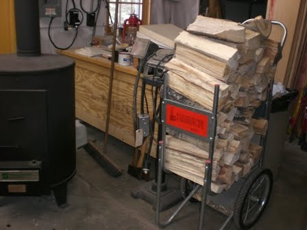 When the rack is full, it gets wheeled through the unheated part of the  garage to its spot near the wood stove in the smaller heated part of the  garage. - A Home Grown Journal: Getting In Wood