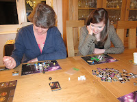 Galaxy Trucker - The ladies examining their respective space crafts