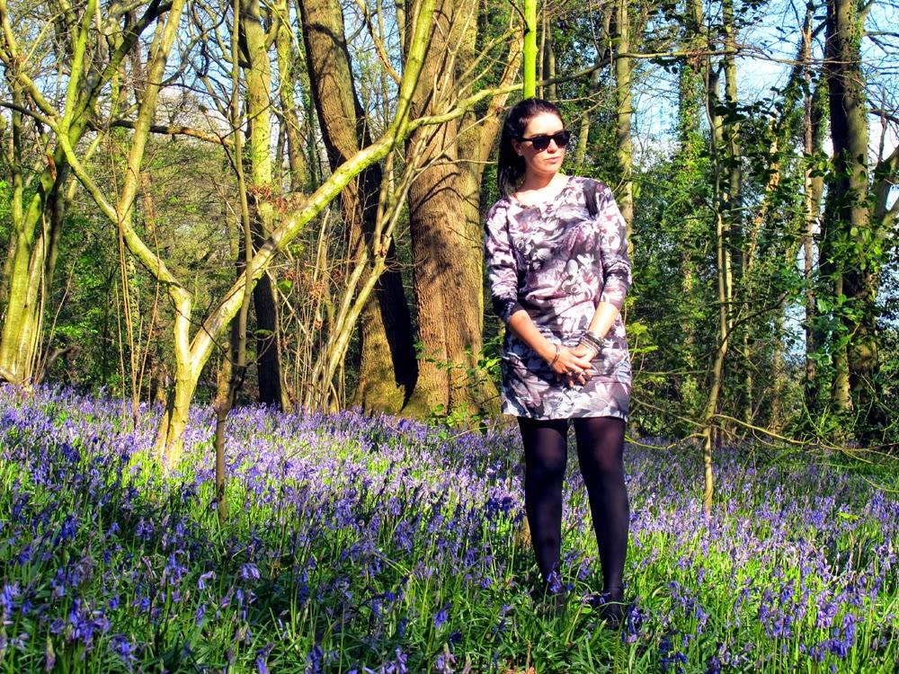 Emma Louise Layla wearing Paul Smith purple rose print dress in Ilkley bluebell woods