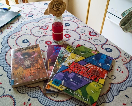 Copies of the Young Avengers and of The Time of the Ghost by Diana Wynne Jones on my kitchen table