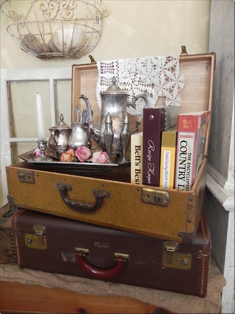 25 awesome suitcase decorating tips the cottage market for Antique books for decoration