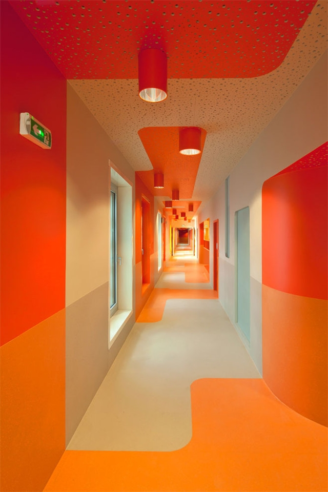 Photo of red and orange painted hallway