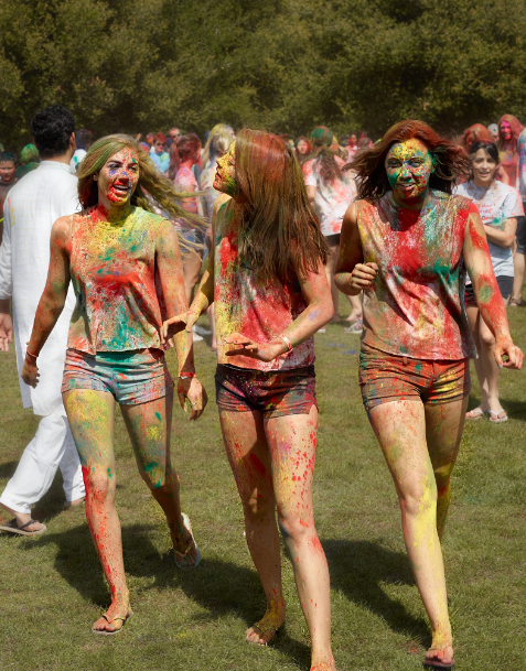 Sexy college girls playing colorful holi
