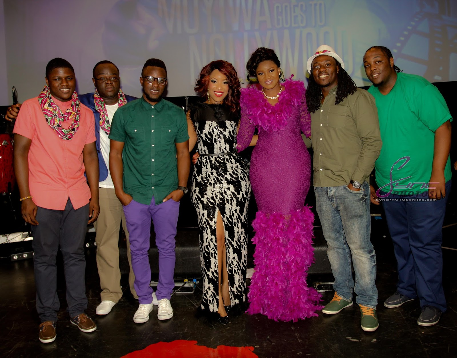 Omotola hot in a royal purple gown at muyiwa goes to nollyood premiere