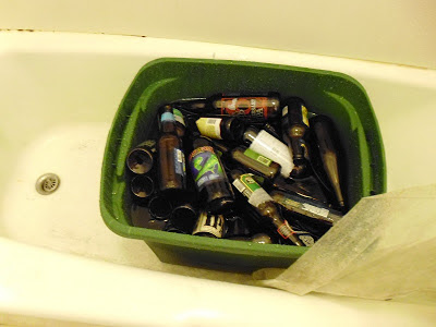 Cleaning bottles in bathtub
