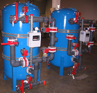 Dual 36 inch greensand filters with bray thirty-one valves and bray series ninety-three pneumatic actuators