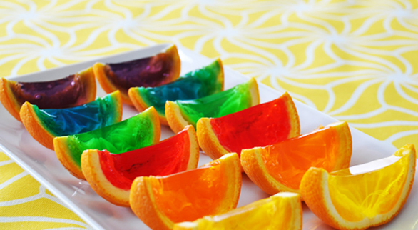 Finish off with some rainbow jello bites served up in orange wedges ...