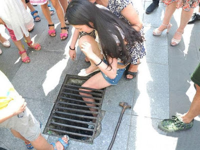 A Chinese teenager's leg was stuck in a storm drain while walking and texting
