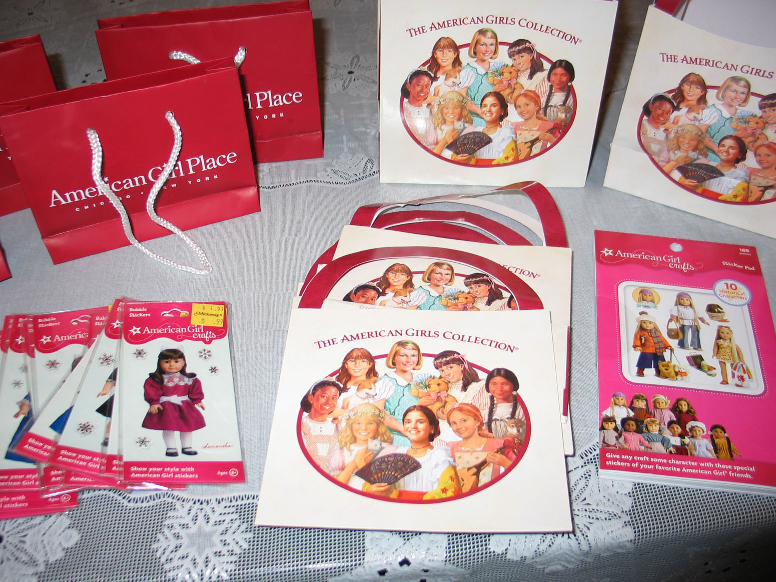 ... invitations from the store and added an American girl sticker on each