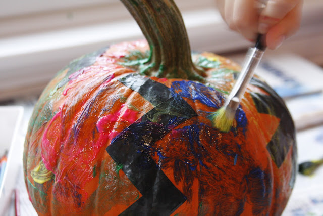painted pumpkin with tape shapes