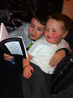 Kian reading Stuart the Bug Eating Man to Isaac