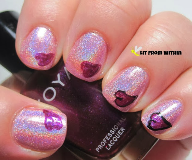 I did the pink heart first in Zoya Mason, and then did an outline with my black nail art striper