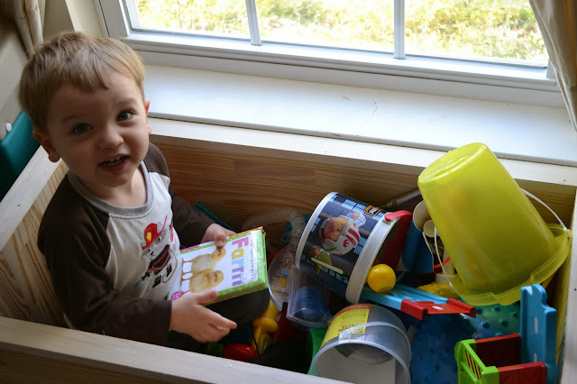 my son playing in his new toy box