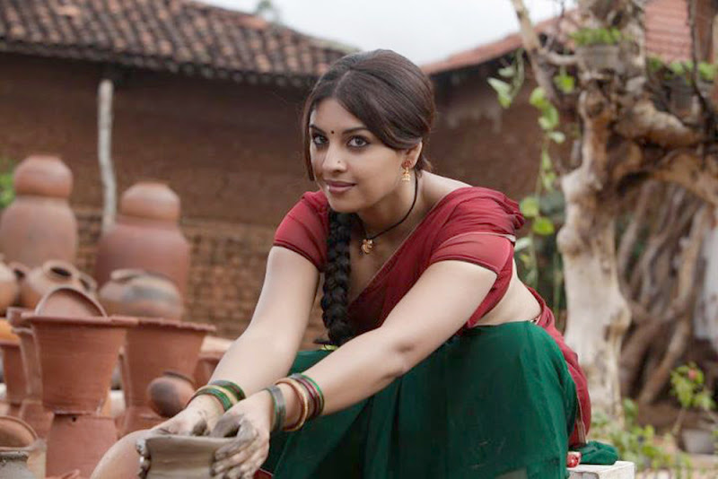 Richa Gangopadhyay Hot Stills In Osthi Movie navel show