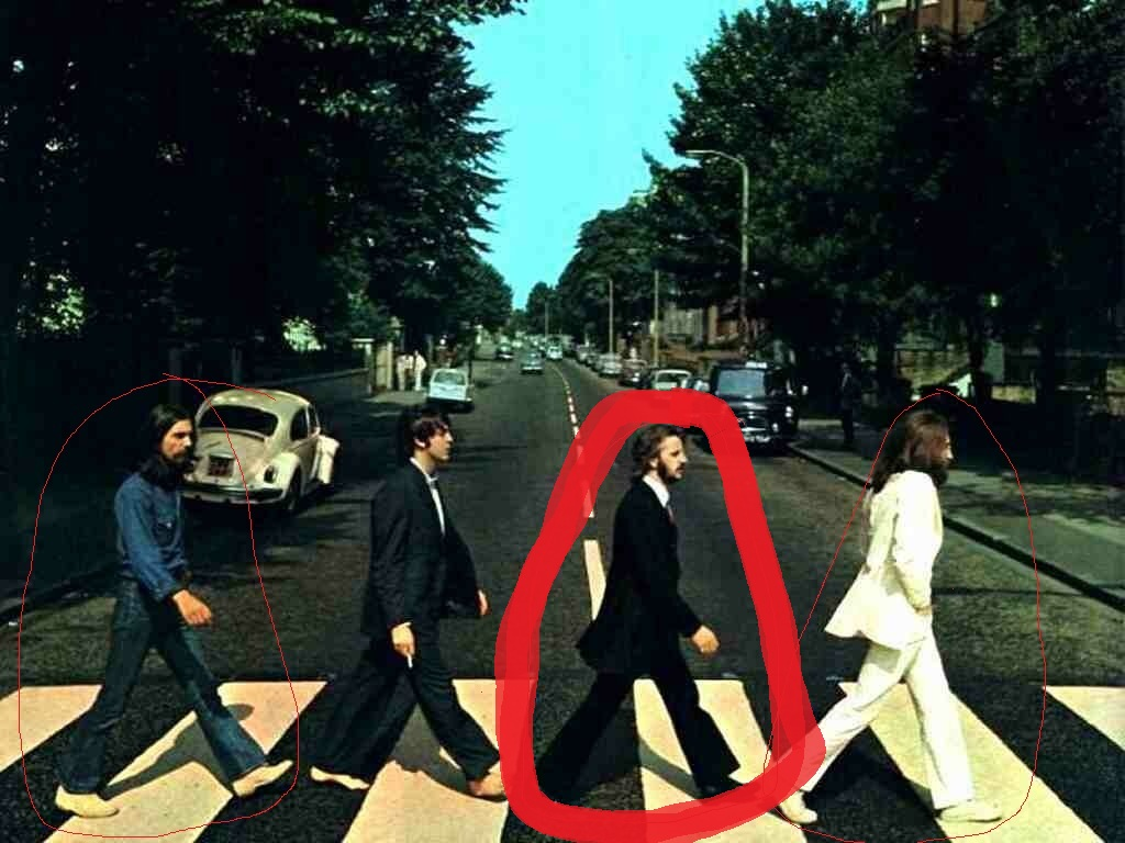 With This Picture Of Ringo Starr Notice That He Is Also Stepping His Left Foot And Dressed As A Pallbearer If Came From Funeral Witch