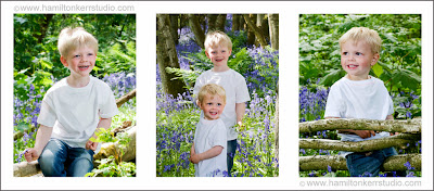 Children playing amongst bluebells in a Scottish woodland landscape