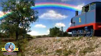 Thomas and friends Annie & Clarabel wooden coaches colorful rainbow high up vivid the summer sky
