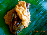 banana leaf wrapped fish in sauce