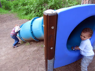 The boys playing with a tube slide