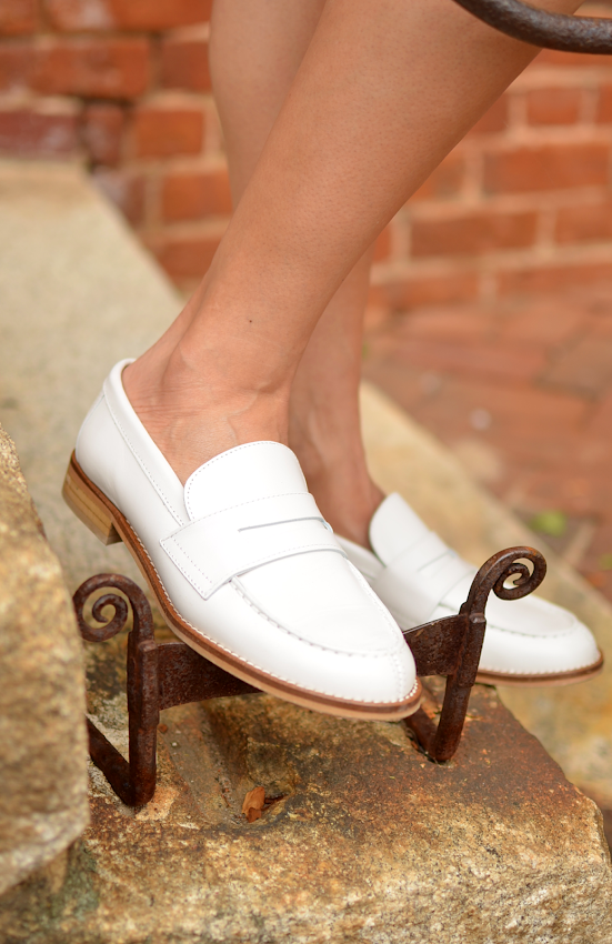 Wearing white loafers