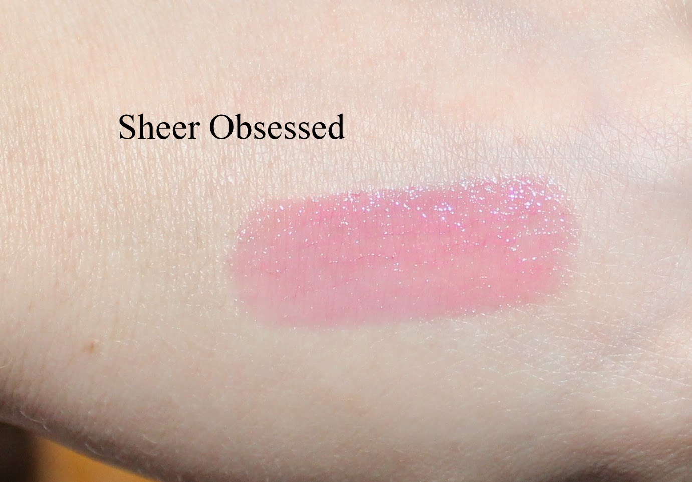 Urban Decay Sheer Revolution Lipstick in Sheer Obsessed Swatch