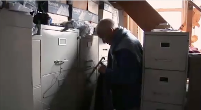 a shot of the photographer Bill Cunningham's apartment full of file cabinets