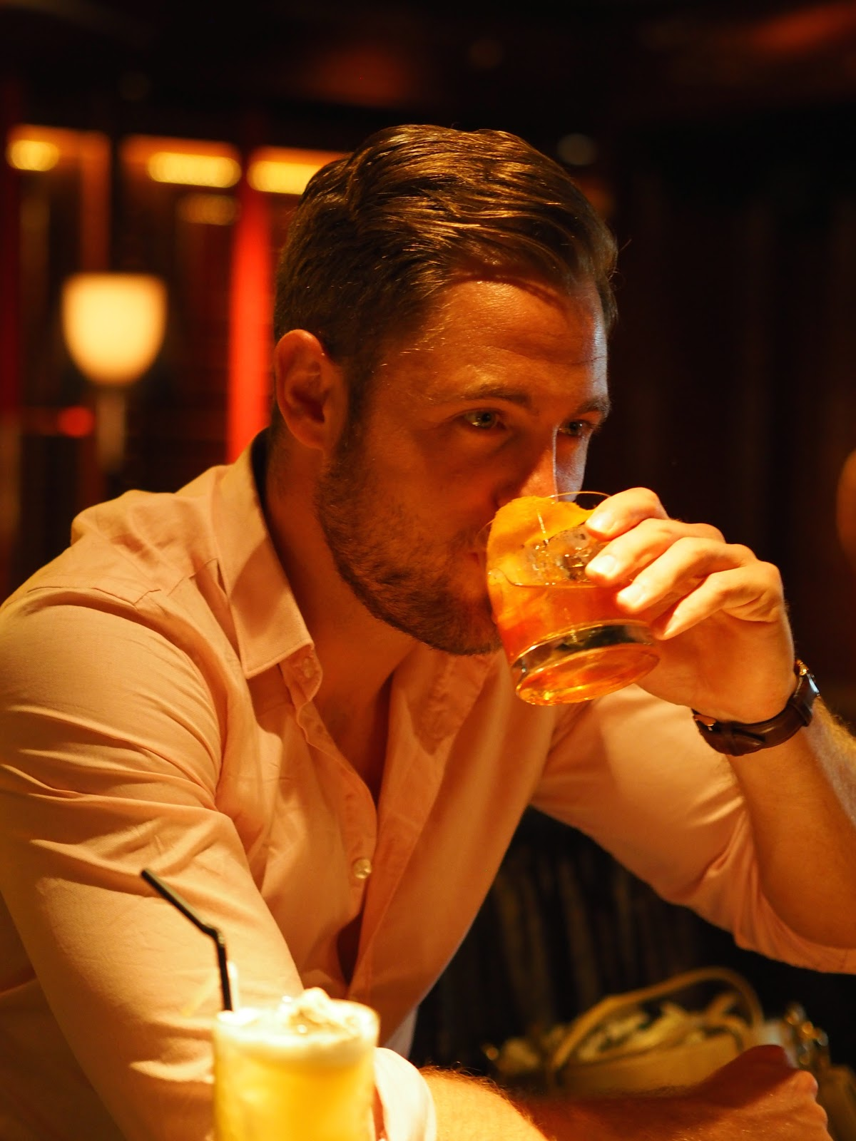 Man sitting at the Peninsula Hotel Bar, Hong Kong