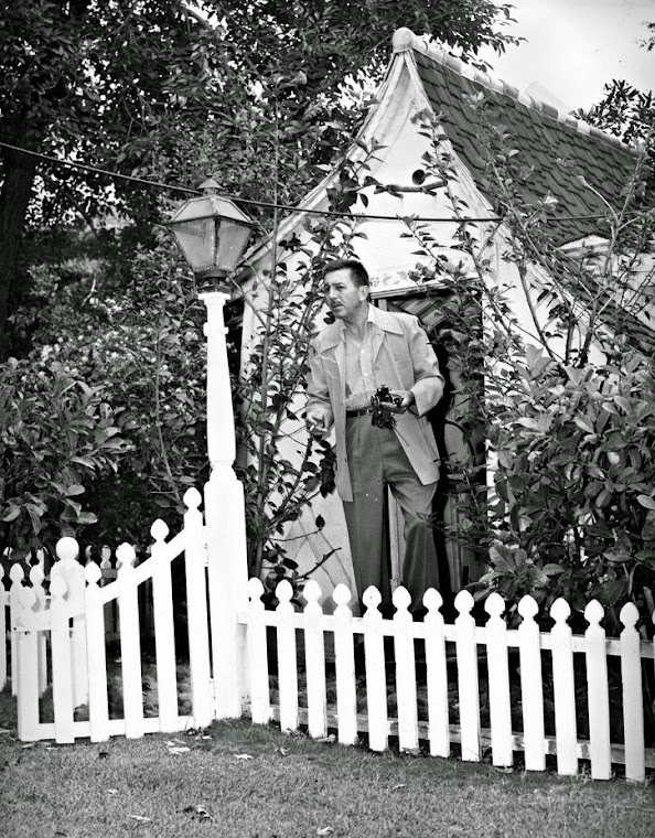 Walt Disney at the playhouse on his property.