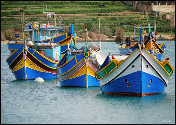 Traditional fishing boats in bright colors at Marsaxlokk, Malta