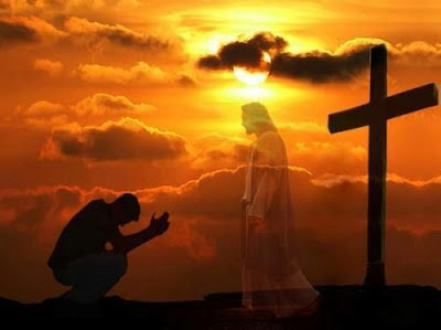 man kneeling to christ in prayer