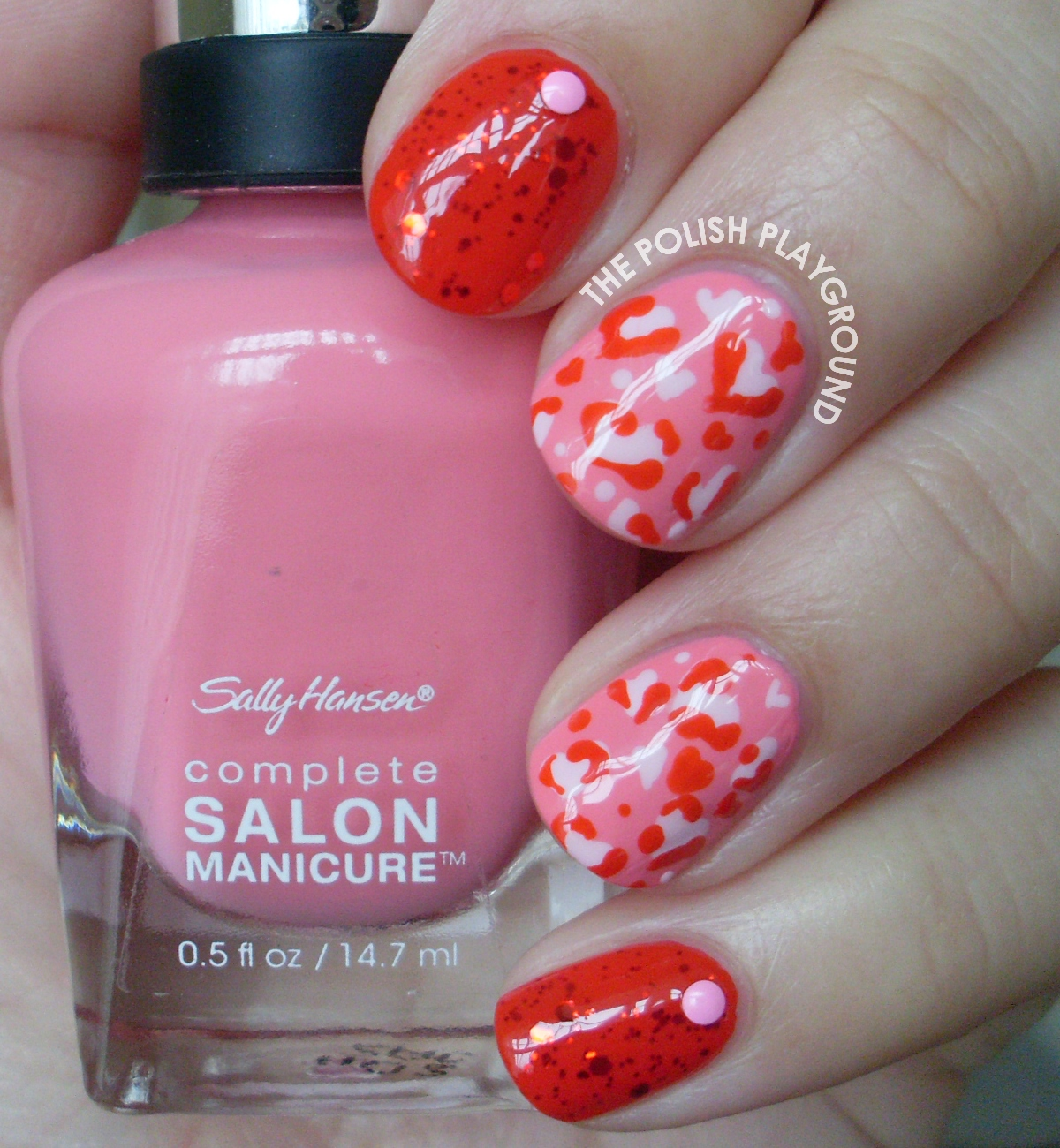 Pink Leopard Hearts and Studs Nail Art
