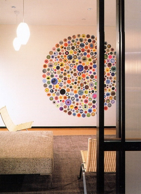[Wall with a bunch of multi-colored round stickers]