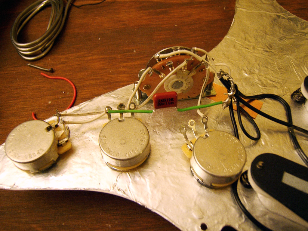 Joe Giampaoli Shielding A Strat Guitar To Eliminate Hum And Emi Noise Switch Wiring Diagram Additionally 1 Humbucker 2 Single Coil Here We Can See The New Tone Capacitor Being Placed I Stripped Another Thin Wire Used Green Plastic Covering Shield Caps Wires So They