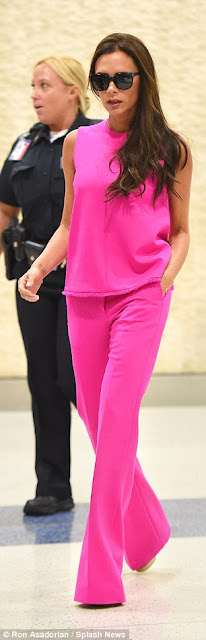 Victoria Beckham stuns in hot pink outfit at JFK airport (photos)  2C13A1F500000578-3226573-image-m-115_1441726602371
