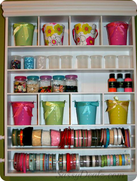 organizing craft supplies with buckets, ribbons, paint for the room